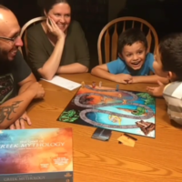 Family playing The Game of Greek Mythology